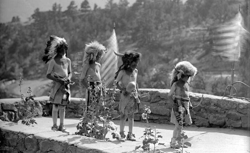 Tesuque Pueblo boys Pete Tim Paul and Clyde Vigil preparing for Buffalo Dance. 1931
