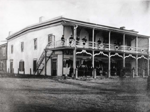 The Johnson Building (circa 1872) at the northeast corner of the Plaza that housed the Signal Service office Nov 18, 1871 – Jun 28, 1873 and Mar 26, 1878 – Mar 1, 1882. View is looking southeast with Washington Avenue to the left and the Plaza to the right. From the Palace of the Governors Angelico Chavez History Library in Santa Fe.