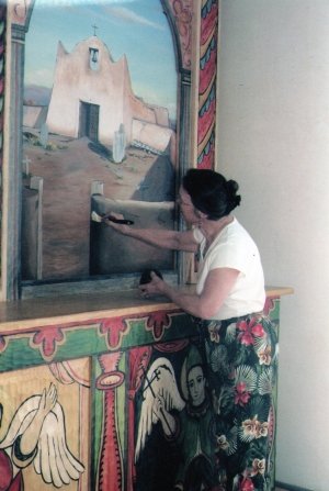 Clare Villa, curator and artist, paints the Pueblo mission of Santa Clara in the Missions of the Rio Arriba series.