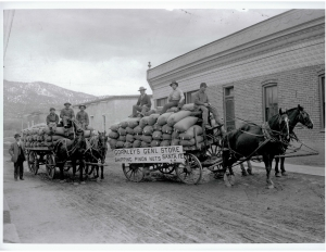 Frank Gormley (at far left) with his piñon loaded wagons, 1925.   Photo most likely by Jesse Nusbaum