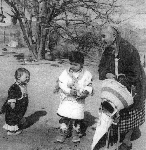 Esther Martinez with  her grandaughter, Celeste, and Jordon Agoyo teaching traditional lifeways. Credit: Josephine Binford